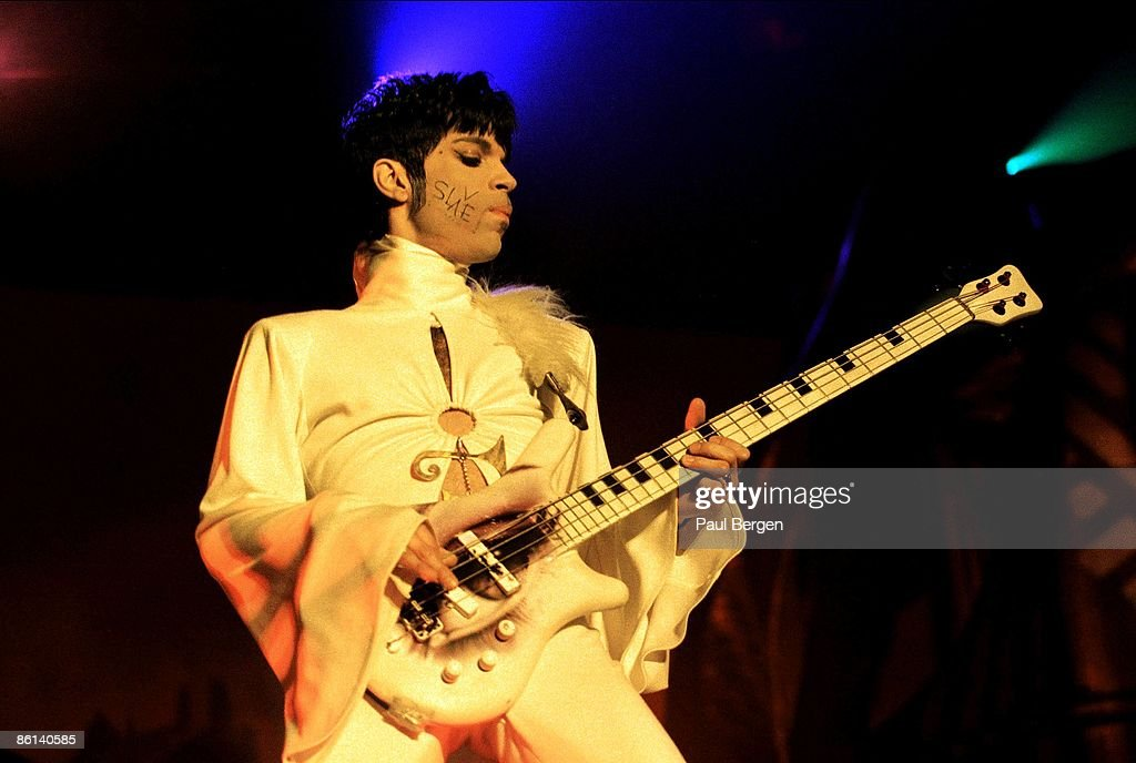 Photo of PRINCE; Prince performing on stage - The Ultimate Live Experience Tour