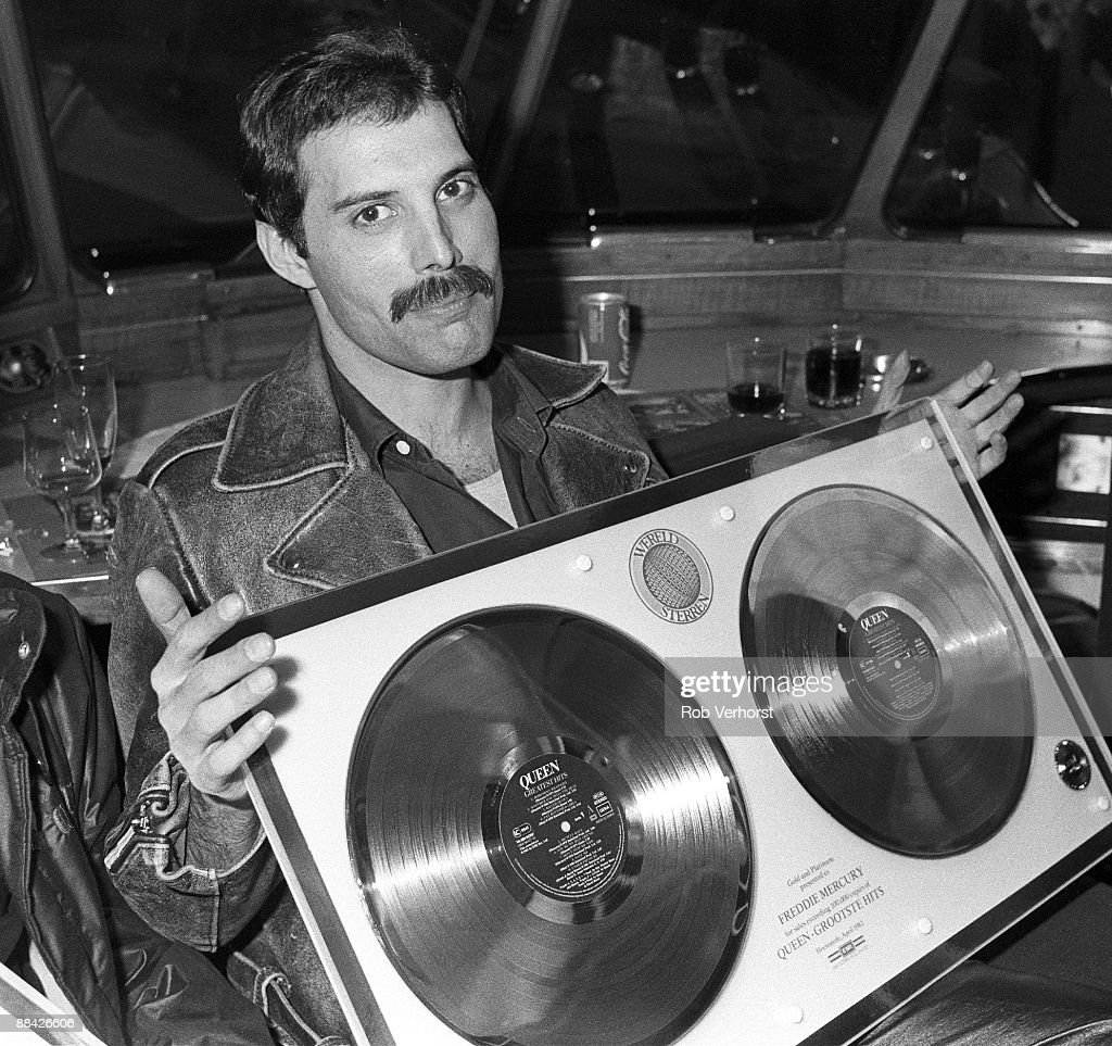 Photo of QUEEN; Collecting gold discs for Greatest Hits - Freddie Mercury