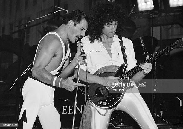 ARENA Photo of QUEEN Freddie Mercury and Brian May performing live on stage