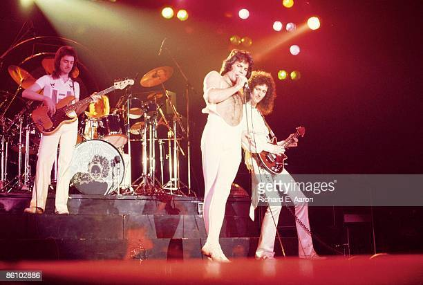 GARDEN Photo of QUEEN L R John Deacon Freddie Mercury and Brian May performing on stage