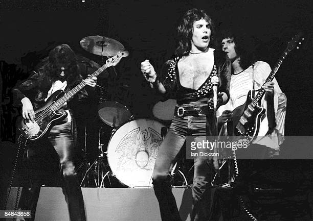 Photo of QUEEN LR John Deacon Freddie Mercury and Brian May performing on stage