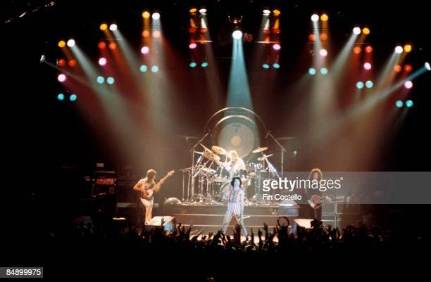 Photo of QUEEN LR John Deacon Freddie Mercury Roger Taylor and Brian May performing on stage