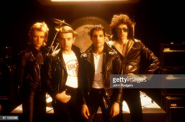 Photo of QUEEN Posed group portrait LR Roger Taylor John Deacon Freddie Mercury and Brian May