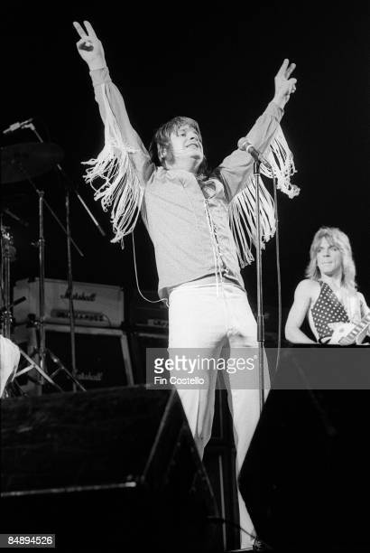 Photo of Randy RHOADS and Ozzy OSBOURNE with Randy Rhoads behind performing live onstage at Gaumont Theatre
