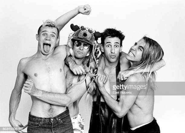 Photo of RED HOT CHILI PEPPERS Cliff MARTINEZ and FLEA and Hillel SLOVAK and Anthony KIEDIS LR Flea Cliff Martinez Hillel Slovak Anthony Kiedis posed...