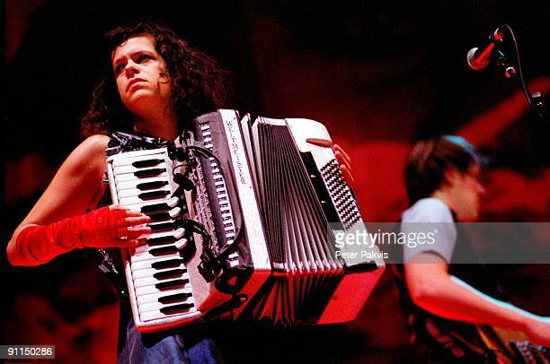 HALL Photo of Regine CHASSAGNE and ARCADE FIRE Regine Chassagne performing on stage playing accordion