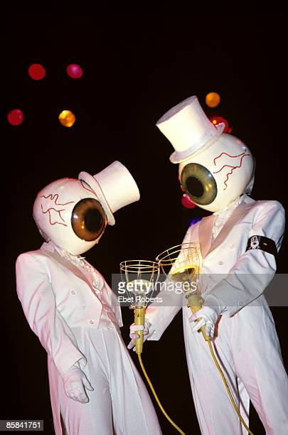CLUB Photo of RESIDENTS performing on stage costume