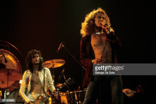 GARDEN Photo of Robert PLANT and Jimmy PAGE and LED ZEPPELIN LR Jimmy Page Robert Plant performing live onstage Photo by George De Sota /Redferns