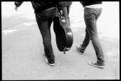 Photo of ROCK GROUP two members of the Pigeon Detectives guitarists rock band indie 2000s style Converse trainers guitar case