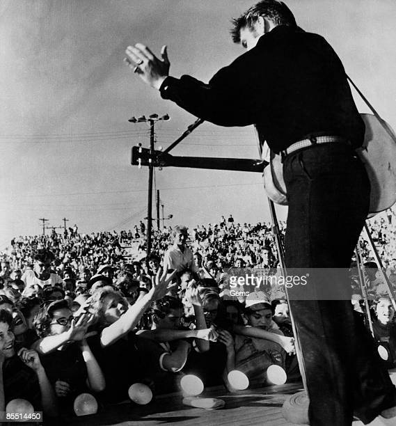 USA Photo of ROCK 'N' ROLL and Elvis PRESLEY and FANS and SCREAMING FANS performing live onstage at the MississippiAlabama Fair and Dairy Show...