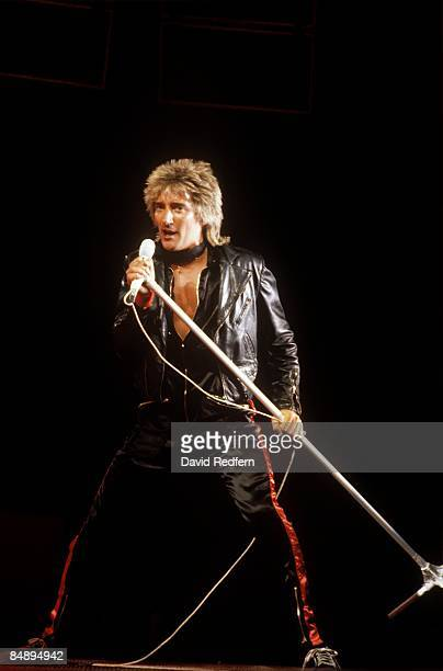 Photo of Rod STEWART performing live onstage full length holding microphone stand