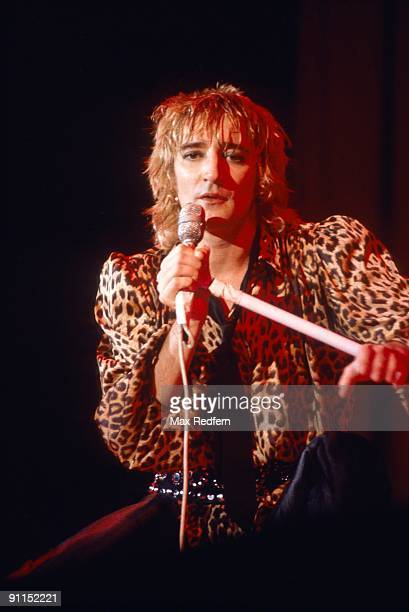 OLYMPIA Photo of Rod STEWART Rod Stewart performing on stage leopardskin