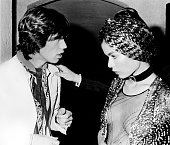 TROPEZ Photo of ROLLING STONES and Bianca JAGGER and Mick JAGGER Mick Jagger talking to wife Bianca Jagger at a party in St Tropez