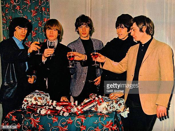 Photo of ROLLING STONES and Charlie WATTS and Mick JAGGER and Keith RICHARDS and Bill WYMAN and Brian JONES Posed group portrait Christmas LR Bill...