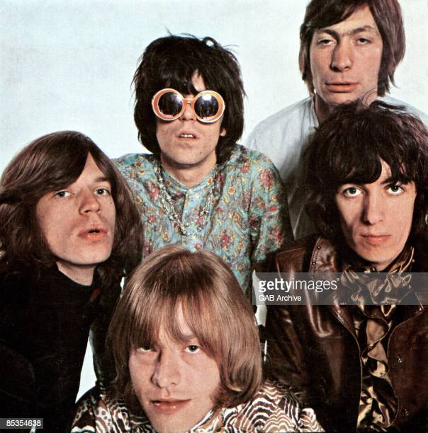 Photo of ROLLING STONES and Charlie WATTS and Mick JAGGER and Keith RICHARDS and Bill WYMAN and Brian JONES Posed group portrait Clockwise from left...