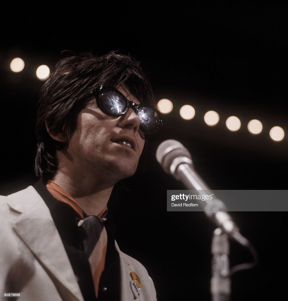 Photo of ROLLING STONES and Keith RICHARDS; of Rolling Stones. performing 'Let's Spend the Night Together' on UK TV, wearing sunglasses