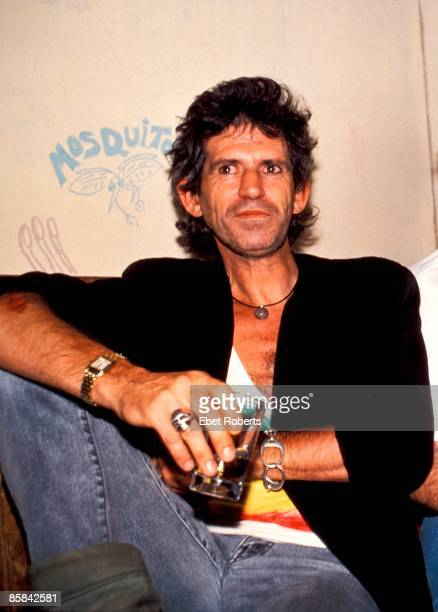 Photo of ROLLING STONES and Keith RICHARDS of the Rolling Stones posed with drink