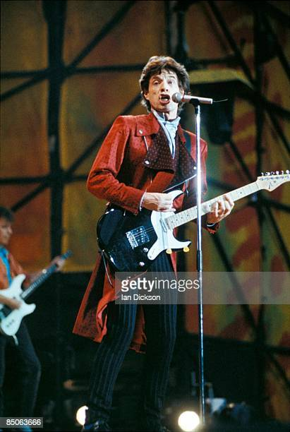 STADIUM Photo of ROLLING STONES and Mick JAGGER of the Rolling Stones with Bill Wyman in background performing live onstage playing guitar on Urban...