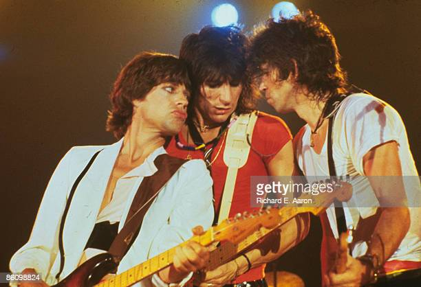 Photo of ROLLING STONES LR Mick Jagger Ron Wood and Keith Richards performing live onstage at the Oshawa Civic Auditorium playing a benefit concert...