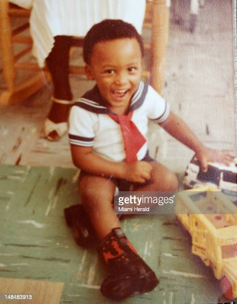 A photo of Rudy Eugene as happy young toddler Eugene was shot to death by Miami police as he crouched over Ronald Poppo's limp body naked and...