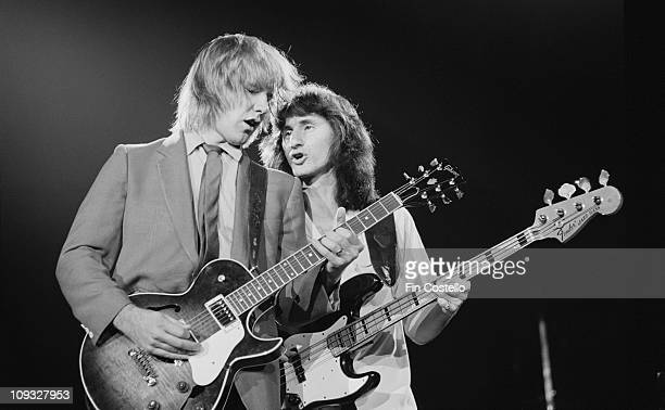 Photo of RUSH LR Alex Lifeson and Geddy Lee performing live onstage on ExitStage Left tour at Wembley Arena in London on November 04 1981