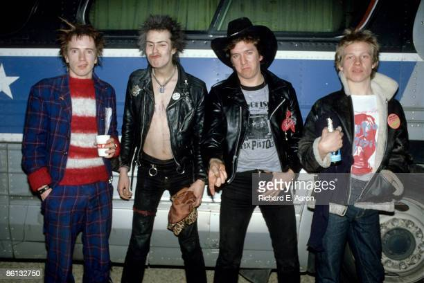 Photo of SEX PISTOLS and Johnny ROTTEN and Sid VICIOUS and Steve JONES and Paul COOK Group portrait in front of bus during their final tour LR Johnny...