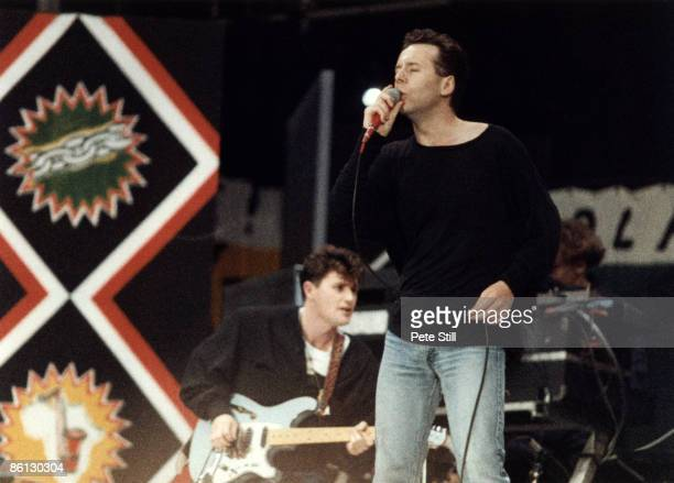 STADIUM Photo of SIMPLE MINDS and Jim KERR Jim Kerr performing on stage at the Nelson Mandela 70th Birthday Tribute concert