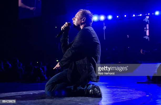 AHOY Photo of SIMPLE MINDS and Jim KERR Jim Kerr performing on stage at the Night of the Proms on knees
