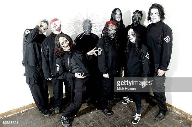 Photo of SLIPKNOT and Chris FEHN and Shawn CRAHAN and Sid WILSON and Craig JONES and Corey TAYLOR and Mick THOMSON and Joey JORDISON and Paul GRAY...