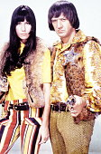 Photo of SONNY CHER and Sonny BONO and CHER Posed portrait of Cher and Sonny Bono with gun