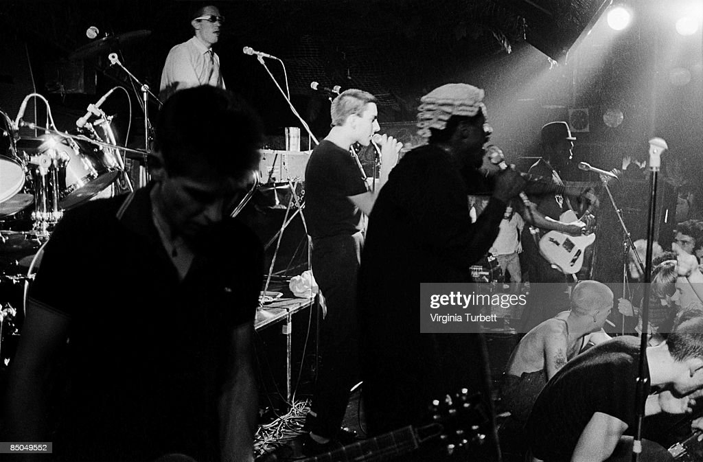 Photo of SPECIALS and Lynval GOLDING and Terry HALL and Roddy RADIATION and Jerry DAMMERS and Neville STAPLE; L-R: Roddy Radiation (front), Jerry Dammers (back), Terry Hall, Neville Staple, Lynval Golding performing live onstage