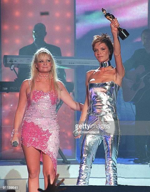 COURT Photo of SPICE GIRLS Emma Bunton and Victoria Beckham on stage holding Brit Award