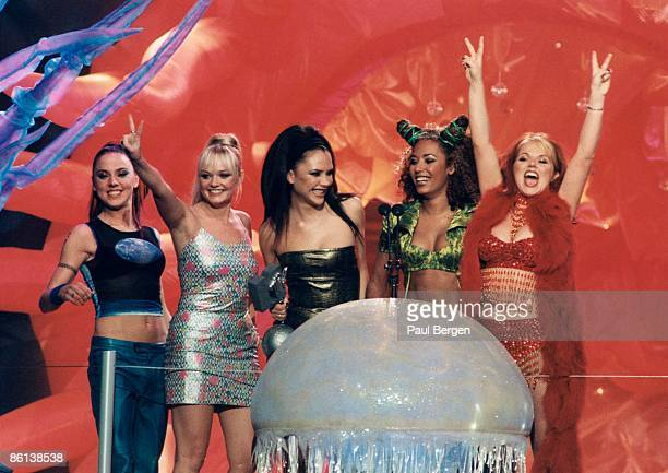 EUROPE Photo of SPICE GIRLS Group on stage collecting award at the MTV Europe Music Awards held in Rotterdam LR Melanie Chisholm Emma Bunton Victoria...