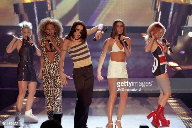 COURT Photo of SPICE GIRLS Group performing live on stage LR Emma Bunton Melanie Brown Melanie Chisholm Victoria Adams and Geri Halliwell Union Jack...