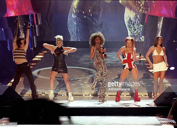 COURT Photo of SPICE GIRLS Group performing live on stage LR Melanie Chisholm Emma Bunton Melanie Brown Geri Halliwell and Victoria Adams