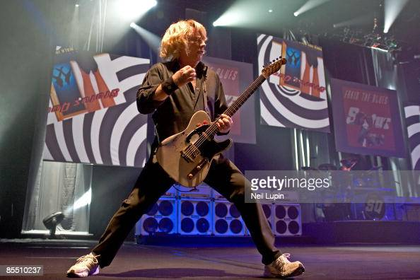 ARENA Photo of STATUS QUO and Rick PARFITT Rick Parfitt performing on stage