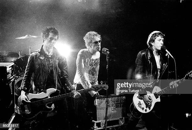 Photo of Steve JONES and Johnny ROTTEN and Sid VICIOUS and SEX PISTOLS LR Sid Vicious Johnny Rotten Steve Jones performing on set of 'Pretty Vacant'...