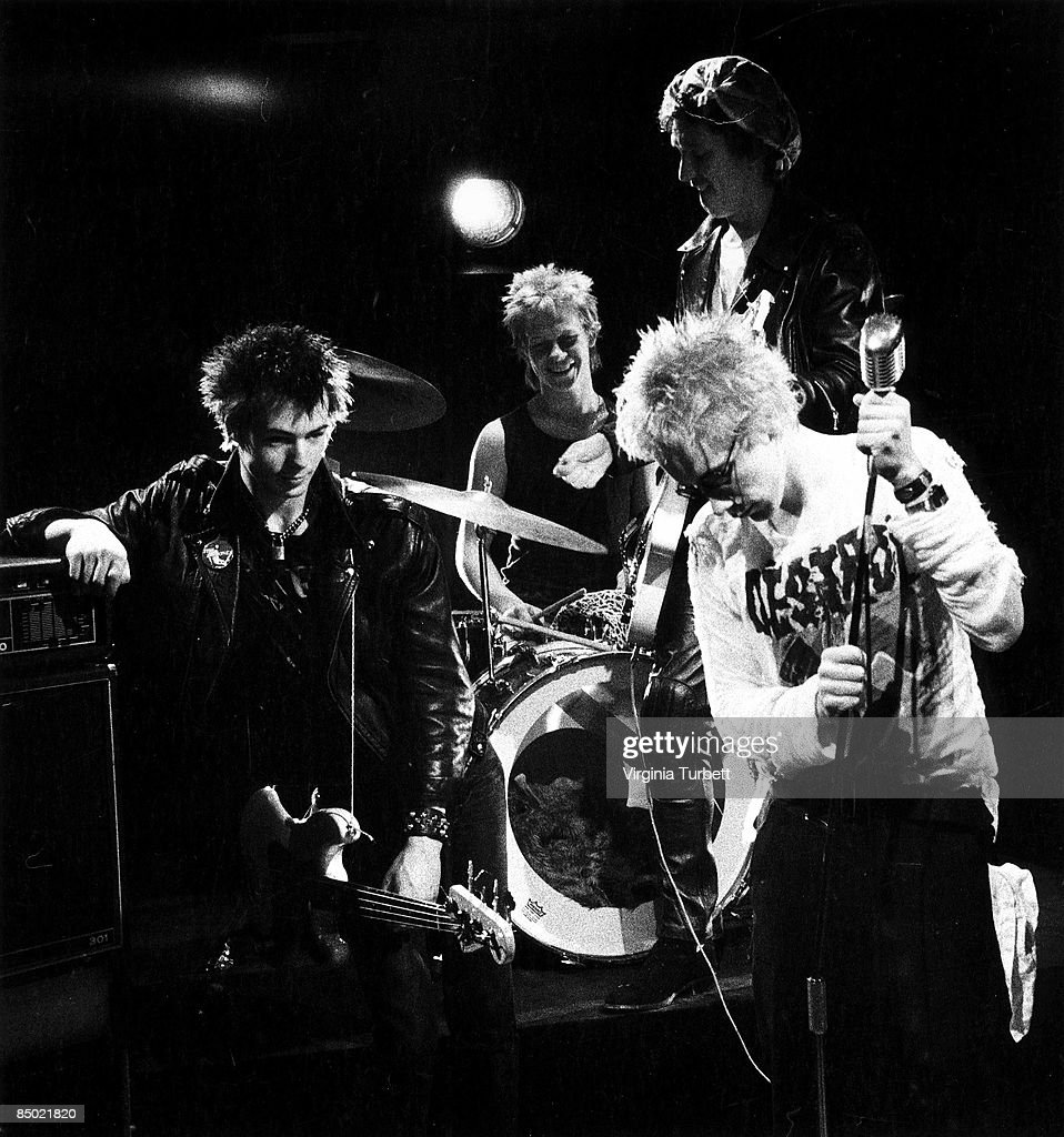 Photo of Steve JONES and Johnny ROTTEN and Sid VICIOUS and SEX PISTOLS; L-R: Sid Vicious, Paul Cook, Steve Jones, Johnny Rotten (John Lydon), posed, group shot, on set of 'Pretty Vacant' video