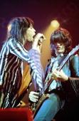Photo of Steven TYLER and AEROSMITH and Joe PERRY Steven Tyler and Joe Perry performing live onstage