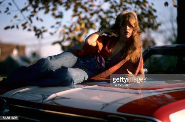 HAVEN Photo of Stevie NICKS and FLEETWOOD MAC Stevie Nicks posed sitting on bonnet of car