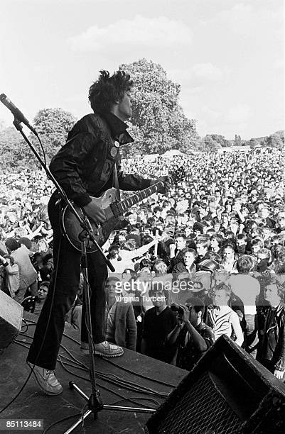 PARK Photo of STIFF LITTLE FINGERS and Jake BURNS Jake Burns performing on stage audience
