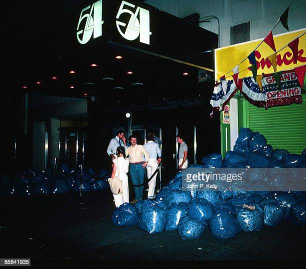 STUDIO 54 Photo of STUDIO 54 club front with rubbish bags piled outside circa 1975