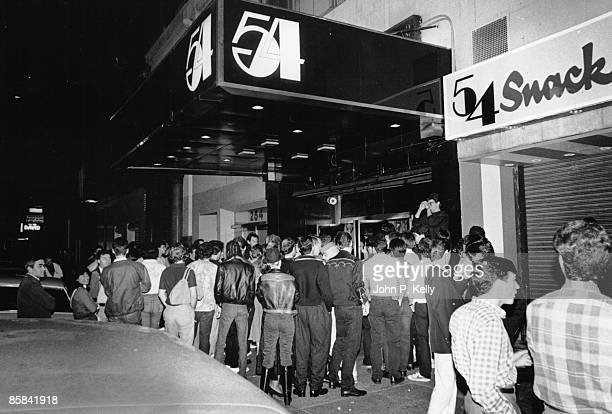STUDIO 54 Photo of STUDIO 54 outside of club showing queue and name sign circa 1975
