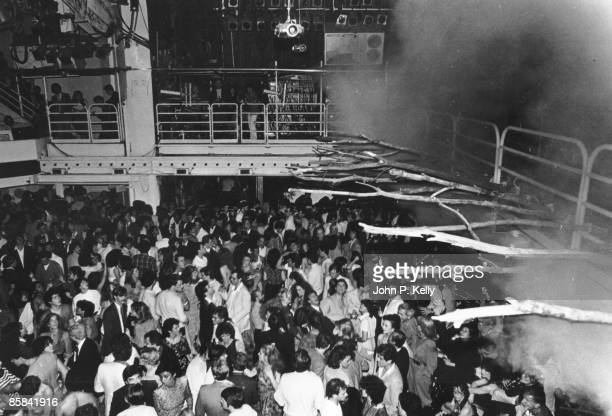 STUDIO 54 Photo of STUDIO 54 view of club showing dancefloor and stage with branches protruding from it circa 1975