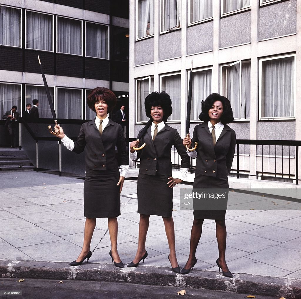 SQUARE Photo of SUPREMES and Florence BALLARD and Mary WILSON and Diana ROSS, Posed full length group portrait outside Manchester Square - Florence Ballard, Mary Wilson, Diana Ross