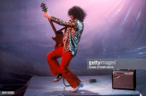 Photo of T REX and Marc BOLAN filming 'Born To Boogie' playing guitar