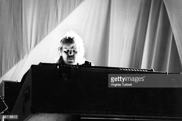 REICHSTAG Photo of TANGERINE DREAM and Edgar FROESE Edgar Froese performing on stage at an antinuclear rally
