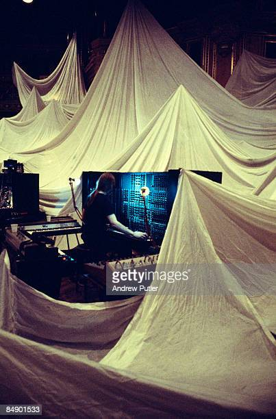 HALL Photo of TANGERINE DREAM Peter Baumann performing on stage white sheets