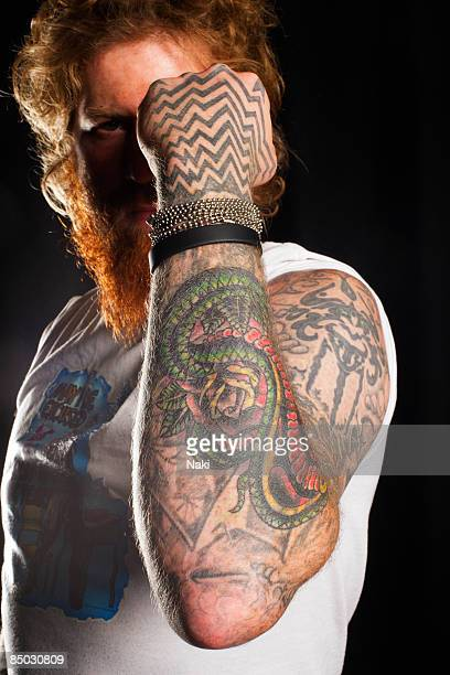 SCALA Photo of TATTOOS and Brent HINDS and MASTADON and MASTODON Col Posed of Brent Hinds displaying his tattoos