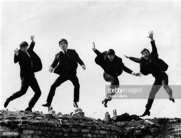 Photo of BEATLES LR Ringo Starr George Harrison Paul McCartney John Lennon posed group shot jumping on wall Used on the Twist Shout EP cover
